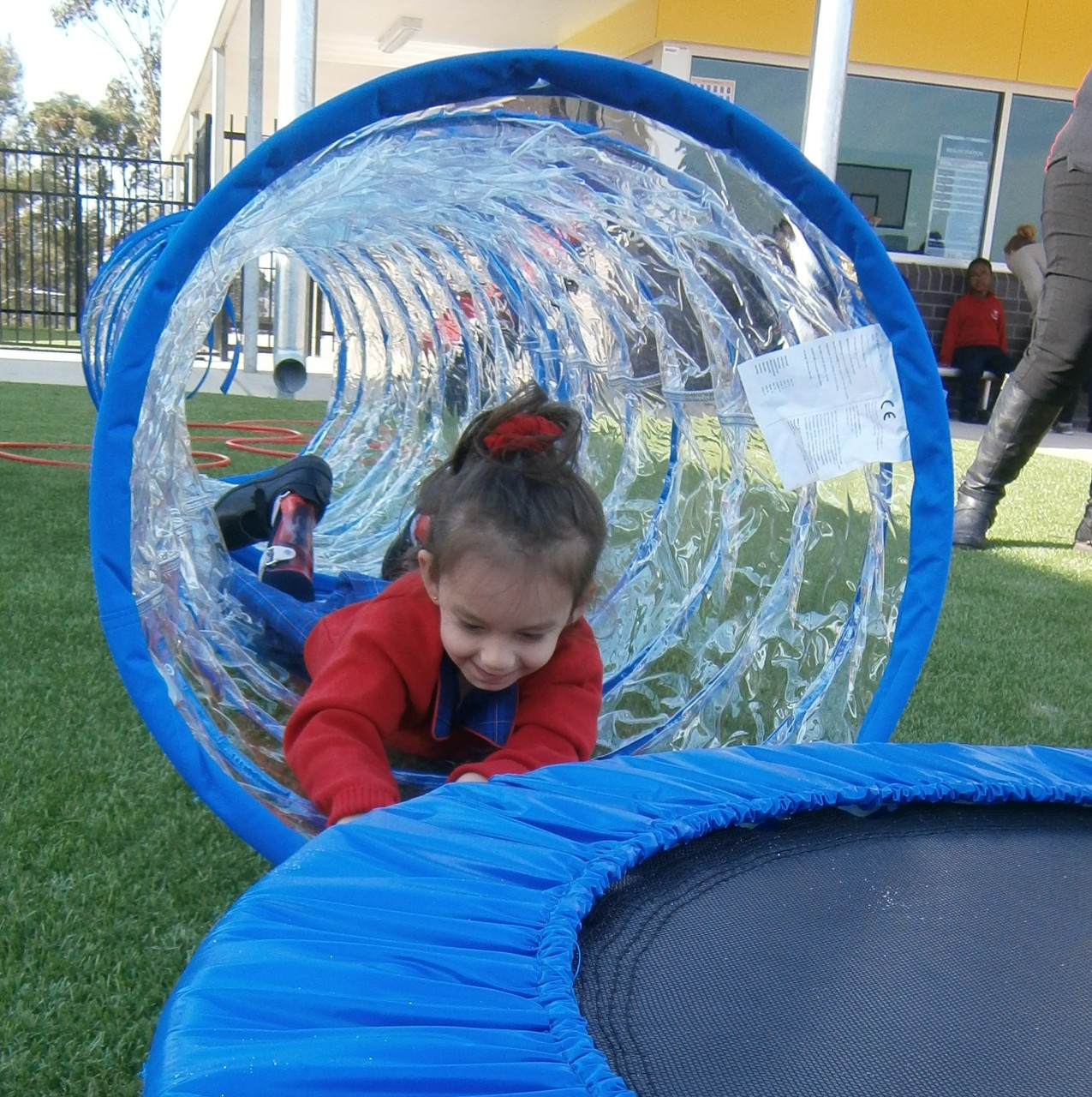 student playing in blue tube